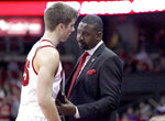 In this Dec. 23, 2015, photo, University of Wisconsin NCAA college basketball assistant coach Howard Moore talks to freshman Alex Illikainen during the second half of a game against University of Wisconsin-Green Bay, in Madison, Wisc. The University of Wisconsin says the wife and daughter of men's basketball assistant coach Howard Moore were killed in a Michigan automobile accident. Wisconsin's athletic department said Moore's wife, Jennifer, and their daughter, Jaidyn, were killed in the crash on M-14 early Saturday, May 25, 2019, in Washtenaw County's Superior Township. Michigan State Police Lt. Darren Green says Howard Moore suffered third-degree burns but his injuries were not considered life-threatening, and his son had minor injuries. (John Hart/Wisconsin State Journal via AP)