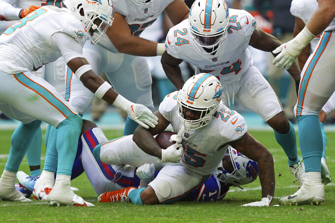 Miami Dolphins cornerback Xavien Howard (25) intercepts a pass intended for Buffalo Bills wide receiver Stefon Diggs (14) during the first half of an NFL football game, Sunday, Sept. 19, 2021, in Miami Gardens, Fla. (AP Photo/Hans Deryk)