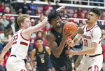 Washington forward Isaiah Stewart (33) drives to the basket against Stanford forwards James Keefe (22) and Jaiden Delaire (11) during the first half of an NCAA college basketball game Thursday, Jan. 9, 2020, in Stanford, Calif. (AP Photo/Tony Avelar)