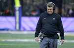 Colorado head coach Mike MacIntyre walks on the sideline during the second half of an NCAA college football game against Washington, Saturday, Oct. 20, 2018, in Seattle. Washington won 27-13. (AP Photo/Ted S. Warren)