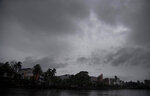 Clouds surrounded in the middle of heavy wind and rain in Gauhati, India, Thursday, May 21, 2020. A powerful cyclone ripped through densely populated coastal India and Bangladesh, blowing off roofs and whipping up waves that swallowed embankments and bridges and left entire villages without access to fresh water, electricity and communications. (AP Photo/Anupam Nath)