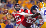Mississippi quarterback Jordan Ta'amu (10) looks for a receiver during the first half of the team's NCAA college football game against LSU in Baton Rouge, La., Saturday, Sept. 29, 2018. LSU won 45-16. (AP Photo/Gerald Herbert)