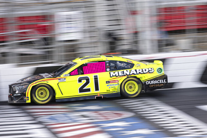 Matt DiBenedetto (21) drives during a NASCAR Cup Series auto racing race at Charlotte Motor Speedway, Sunday, Oct. 10, 2021, in Concord, N.C. (AP Photo/Matt Kelley)