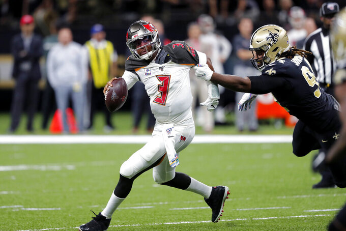 Tampa Bay Buccaneers quarterback Jameis Winston (3) scrambles under pressure from New Orleans Saints defensive end Cameron Jordan in the first half of an NFL football game in New Orleans, Sunday, Oct. 6, 2019. (AP Photo/Bill Feig)