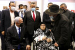 Israeli Prime Minister Benjamin Netanyahu, left, visits a coronavirus vaccination facility in Jerusalem, Wednesday, Jan. 6, 2021. (Marc Israel Sellem/Pool via AP)