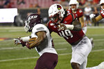 Louisville linebacker Boosie Whitlow (49) grabs Eastern Kentucky running back Daryl McCleskey Jr. (22) during the second half of an NCAA college football game in Louisville, Ky., Saturday, Sept. 7, 2019. (AP Photo/Timothy D. Easley)