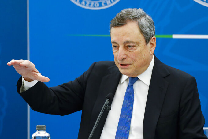Italian Premier Mario Draghi gestures as he addresses the media during a news conference to illustrate the government's new measures to cope with COVID-19 pandemic, in Rome, Friday, April 16, 2021. (Remo Casilli/Pool via AP)