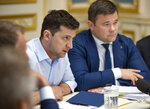 Ukrainian president Volodymyr Zelenskiy speaks during a meeting with the lawmakers in Kiev, Ukraine, Tuesday, May 21, 2019. Zelenskiy dropped a bombshell when he said he is dissolving the parliament, dominated by allies of the former Ukrainian president. Zelenskiy sat down with political leaders Tuesday morning to discuss the dissolution. Andriy Bohdan, adviser to Volodymyr Zelenskiy is at right. (Ukrainian Presidential Press Office via AP)