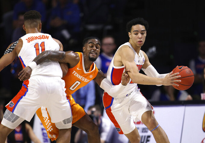 Tennessee guard Jordan Bone (0) is fouled by Florida forward Keyontae Johnson (11) while guarding Florida guard Andrew Nembhard (2) during the first half of an NCAA college basketball game Saturday, Jan. 12, 2019, in Gainesville, Fla. (AP Photo/Matt Stamey)