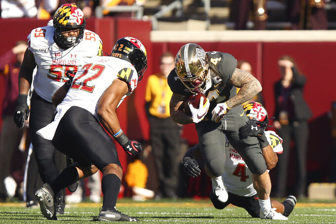 Minnesota running back Shannon Brooks (4) holds onto the ball against Maryland linebacker Keandre Jones (4) during an NCAA college football game Saturday, Oct. 26, 2019, in Minneapolis. (AP Photo/Stacy Bengs)