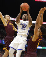 Buffalo's Dontay Caruthers (22) drives to the basket between Central Michigan's Larry Austin Jr. (0) and Robert Montgomery (5) during the second half of an NCAA college basketball game in the semifinals of the Mid-American Conference men's tournament Friday, March 15, 2019, in Cleveland. Buffalo won 85-81. (AP Photo/Tony Dejak)