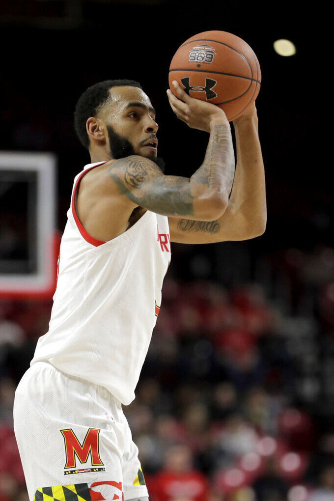 Maryland guard Eric Ayala looks to shoot against Rhode Island during the first half of an NCAA college basketball game, Saturday, Nov. 9, 2019, in College Park, Md. (AP Photo/Julio Cortez)