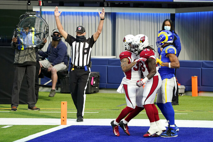 Arizona Cardinals running back Jonathan Ward, center, celebrates after scoring a rushing touchdown against the Los Angeles Rams during the first half of an NFL football game Sunday, Jan. 3, 2021, in Inglewood, Calif. (AP Photo/Ashley Landis )