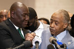 FILE - In this April 20, 2021 file photo, Attorney Ben Crump, left, and Rev. Al Sharpton shake hands during a news conference after former Minneapolis police Officer Derek Chauvin is convicted in the killing of George Floyd, in Minneapolis. Sharpton and an attorney for George Floyd's family are speaking at the memorial Tuesday, July 6, 2021, for a white Arkansas teenager shot dead by a deputy, a case that civil rights activists say highlights the need for interracial support to address police shootings. (AP Photo/John Minchillo File)
