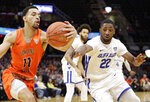 Bowling Green's Antwon Lillard (11) grabs a rebound ahead of Buffalo's Dontay Caruthers (22) during the first half of an NCAA college basketball championship game of the Mid-American Conference men's tournament, Saturday, March 16, 2019, in Cleveland. (AP Photo/Tony Dejak)
