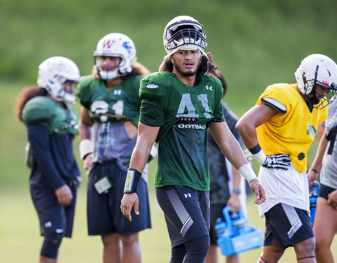 In this Sept. 26, 2018, photo, Hawaii's Scheyenne Sanitoa (41) and teammates practice in Honolulu. Sanitoa died on Thursday, July 4, 2019, the school said in a statement Friday. He was 21. University spokesman Derek Inouchi said the death did not happen on campus, and Sanitoa was not involved in any athletics department activities at the time of his death. (Dennis Oda/Honolulu Star-Advertiser via AP)