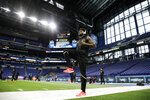 Utah defensive back Jaylon Johnson stretches at the NFL football scouting combine in Indianapolis, Sunday, March 1, 2020. (AP Photo/Charlie Neibergall)