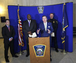 Onondaga County District Attorney William J. Fitzpatrick, center, speaks at a news conference at the Syracuse Police Department in Syracuse, N.Y., Thursday, Feb. 21, 2019, about Syracuse men's NCAA college basketball head coach Jim Boeheim's involvement in a fatal car accident where he struck and killed a man standing along an interstate in Syracuse. Boeheim struck and killed a man along an interstate late Wednesday night as he tried to avoid hitting the man's disabled vehicle, police say. (AP Photo/Nick Lisi)