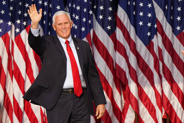 Vice President Mike Pence waves to supporters before speaking at a campaign rally, Wednesday, Sept. 16, 2020, in Zanesville, Ohio. (AP Photo/Tony Dejak)