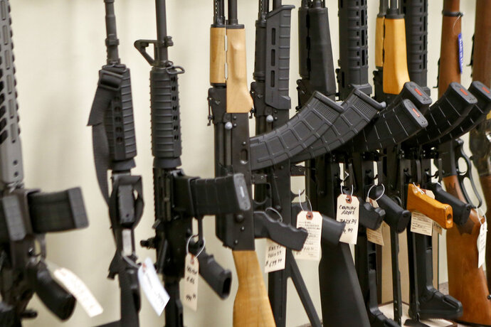 FILE - This March 1, 2018 file photo shows a display of various models of semi-automatic rifles at a store in Pennsylvania. Research published Tuesday, Sept. 11, 2018 in the Journal of the American Medical Association shows active shooters with semi-automatic rifles wound and kill twice as many people as those using non-automatic weapons. (AP Photo/Keith Srakocic)