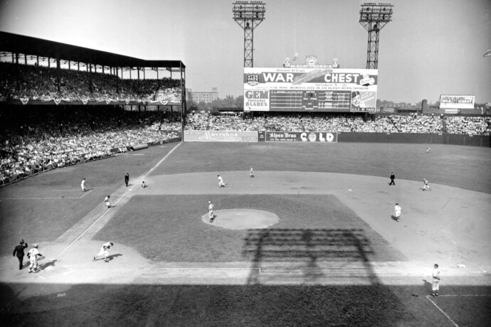 FILE - In this Oct. 4, 1944, file photo, St. Louis Cardinals' Danny Litwhiler heads to first base as St. Louis Browns third baseman Mark Christman fields his ground ball before forcing out Browns' Ray Sanders, heading to third, for the third out during the third inning in the opening game of the 1944 World Series at Sportsman's Park in St. Louis, Mo. The Browns won 2-1. The last time the World Series was held in a single ballpark was 1944.  (AP Photo/FIle)