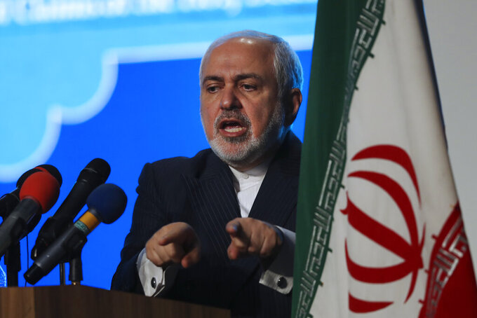 Iran's Foreign Minister Mohammad Javad Zarif addresses in a conference in Tehran, Iran, Tuesday, Feb. 23, 2021. Following the conference Zarif told journalists the country has started implementing a law passed by the parliament to curb UN inspections into its nuclear program and would no longer share surveillance footage of its nuclear facilities with the U.N. agency. (AP Photo/Vahid Salemi)