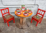 In this May 24, 2020 photo provided by Rick Everett, a small table decorated with succulents sits below a window where Everett offers free coffee and conversation to friends and neighbors at his home in Sydney, Australia during the coronavirus pandemic. (Rick Everett via AP)