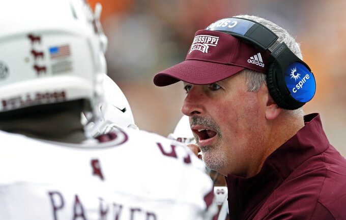 Mississippi State head coach Joe Moorhead talks to his players during a timeout in the second half of an NCAA college football game against Tennessee, Saturday, Oct. 12, 2019, in Knoxville, Tenn. (AP Photo/Wade Payne)