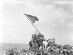 FILE - In this Feb 23, 1945, file photo, U.S. Marines of the 28th Regiment, 5th Division, raise the American flag atop Mt. Suribachi, Iwo Jima, Japan. (AP Photo/Joe Rosenthal, File)