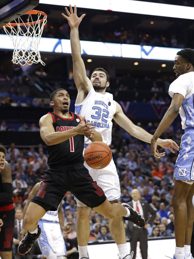 Louisville's Christen Cunningham (1) is fouled as he drives past North Carolina's Luke Maye (32) during the second half of an NCAA college basketball game in the Atlantic Coast Conference tournament in Charlotte, N.C., Thursday, March 14, 2019. (AP Photo/Chuck Burton)