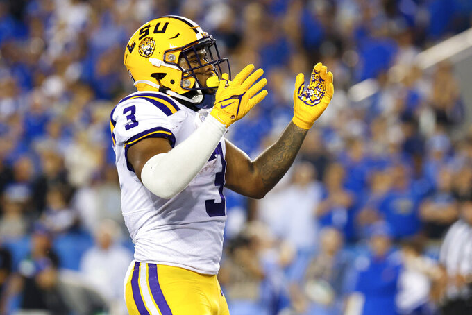 LSU running back Tyrion Davis-Price celebrates his touchdown during the second half of the team's NCAA college football game against Kentucky in Lexington, Ky., Saturday, Oct. 9, 2021. (AP Photo/Michael Clubb)