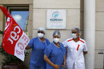 Employees demonstrating outside a nursing home of the Korian group, one of the market leaders in the lucrative industry of providing care and assisted living facilities for older adults, Monday, May 25, 2020 in Paris. In France, the group is facing several lawsuits filed by families who have lost loved ones during the coronavirus pandemic that has caused thousands of deaths in French care homes. (AP Photo/Thibault Camus)