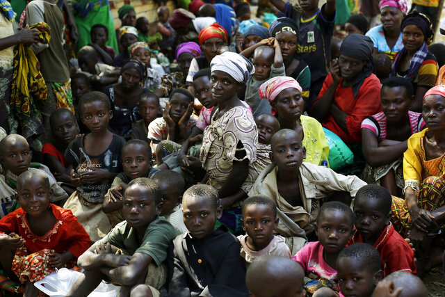 FILE - In this Saturday, May 23, 2015 file photo, refugees who fled Burundi's violence and political tension wait to board a UN ship, at Kagunga on Lake Tanganyika, Tanzania, to be taken to the port city of Kigoma. At least 18 Burundian refugees and asylum seekers have been forcibly disappeared from refugee camps in Tanzania over roughly the past year, with many being tortured at a police station in Tanzania and seven remain missing, according to a new report by Human Rights Watch. (AP Photo/Jerome Delay, File)