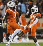 Virginia Tech defensive players Devon Hunter (7) and Armani Chatman (27) celebrate an interception against North Carolina during the second half of an NCAA college football game Friday, Sept. 3, 2021, in Blacksburg, Va. (Matt Gentry/The Roanoke Times via AP)