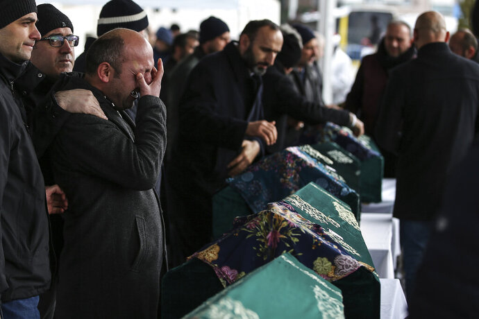 Mourners attend the funeral prayers for nine members of Alemdar family killed in a collapsed apartment building, in Istanbul, Saturday, Feb. 9, 2019. Turkey's President Recep Tayyip Erdogan says there are