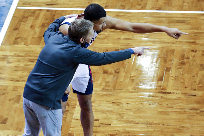 Gonzaga guard Jalen Suggs (1) and head coach Mark Few discuss strategy during the second half of an NCAA college basketball game against Iowa, Saturday, Dec. 19, 2020 in SIoux Falls, S.D. (AP Photo/Josh Jurgens)