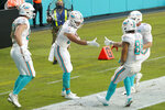 Miami Dolphins tight end Durham Smythe (81) is congratulated by wide receiver Mack Hollins (86) after Smythe scored a touchdown, during the first half of an NFL football game against the New York Jets, Sunday, Oct. 18, 2020, in Miami Gardens, Fla. (AP Photo/Wilfredo Lee)