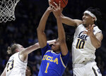 California's Justice Sueing, right, tries to strip the ball from UCLA's Moses Brown (1) during the second half of an NCAA college basketball game Wednesday, Feb. 13, 2019, in Berkeley, Calif. At left is California's Connor Vanover. (AP Photo/Ben Margot)