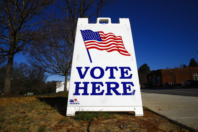 A vote here sign is seen outside a polling place during the South Carolina primary, Saturday, Feb. 29, 2020, in Columbia, S.C. (AP Photo/Matt Rourke)