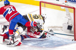 Boston Bruins right wing David Pastrnak (88) and Montreal Canadiens defenseman David Schlemko (21) fall over Montreal Canadiens goaltender Carey Price (31) as the puck goes in the net for the fourth goal during third period NHL hockey action in Montreal on Monday, Dec. 17, 2018. (Ryan Remiorz/The Canadian Press via AP)