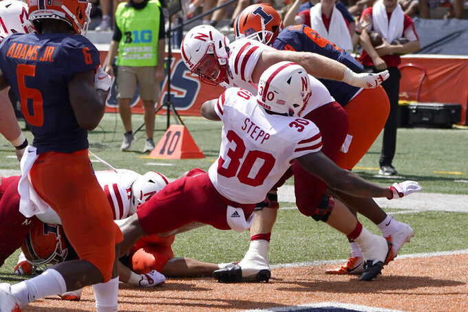 Nebraska running back Markese Stepp backs into the end zone for a touchdown during the first half of an NCAA college football game against the Illinois Saturday, Aug. 28, 2021, in Champaign , Ill. (AP Photo/Charles Rex Arbogast)