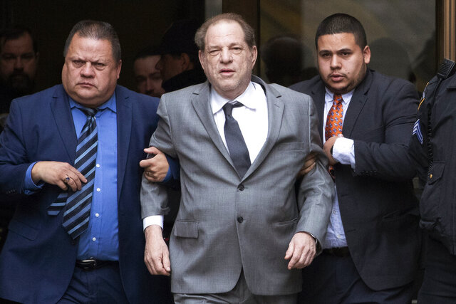 FILE - This Dec. 6, 2019 file photo shows Harvey Weinstein, center, leaving court following a bail hearing in New York. A former model who accused Weinstein last year of sexually abusing her when she was 16 filed a new lawsuit against him Thursday, Dec. 19, saying she didn't want to be included in a proposed global settlement that would split $25 million among various accusers. (AP Photo/Mark Lennihan, File)