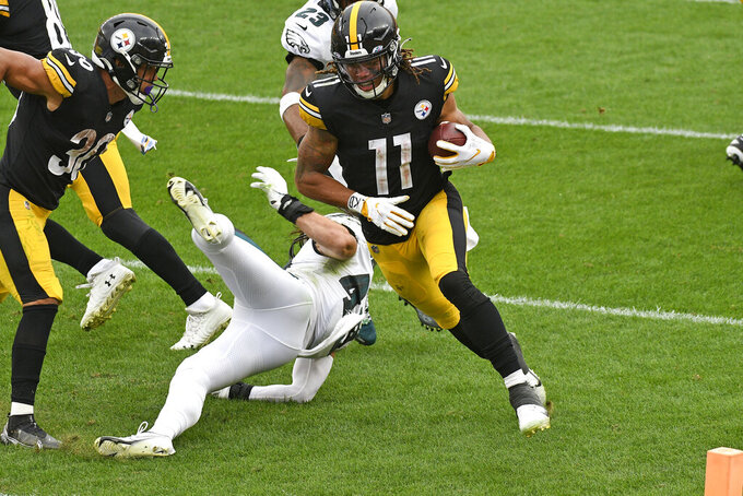 Pittsburgh Steelers wide receiver Chase Claypool (11) scores on a 3-yard pass play during the second half of an NFL football game against the Philadelphia Eagles in Pittsburgh, Sunday, Oct. 11, 2020. (AP Photo/Don Wright)