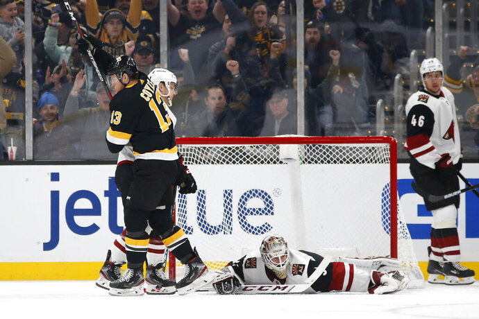 Boston Bruins' Charlie Coyle celebrates his goal on Arizona Coyotes goaltender Adin Hill during the second period of an NHL hockey game Saturday, Feb. 8, 2020, in Boston. (AP Photo/Winslow Townson)