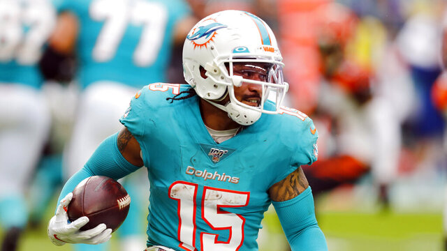 FILE - In this Dec. 22, 2019 file photo Miami Dolphins wide receiver Albert Wilson runs the football during the first half at an NFL football game against the Cincinnati Bengals in Miami Gardens, Fla. Dolphins newcomer Tua Tagovailoa is starting to connect with his receivers. And for now, veteran receiver Albert Wilson said Wednesday, May 13, 2020 long-distance hookups with the rookie quarterback will have to do. (AP Photo/Brynn Anderson, file)