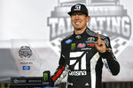 Kyle Busch poses with the trophy after winning the NASCAR Truck Series auto race at Atlanta Motor Speedway, Saturday, Feb. 23, 2019, in Hampton, Ga. (AP Photo/John Amis)
