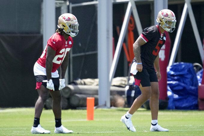 San Francisco 49ers rookie quarterback Trey Lance, right, and running back Trey Sermon, left, run drills during NFL football rookie minicamp in Santa Clara, Calif., Friday, May 14, 2021. (AP Photo/Tony Avelar)