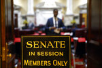FILE - In this Wednesday, Jan. 9, 2019 file photo, a sign stands outside an entrance to the Maryland State Senate chamber in Annapolis, Md., on the first day of the state's 2019 legislative session. The U.S. Supreme Court has scheduled arguments in March 2019 on an appeal of a ruling that western Maryland's 6th Congressional District is an unconstitutional partisan gerrymander that diluted the voting power of Republicans. (AP Photo/Patrick Semansky)
