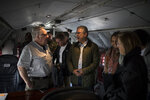 In this Jan. 29, 2020 photo, Howard Buffett, left, talks to Colombia's President Ivan Duque aboard an air force plane before departing from Bogota, Colombia. Duque has vowed to slash cocaine production in half by the end of 2023. (AP Photo/Ivan Valencia)