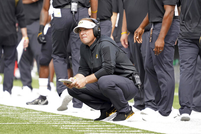 Missouri head coach Eliah Drinkwitz looks on from the sideline during the first half of an NCAA college football game against Boston College, Saturday, Sept. 25, 2021, in Boston. (AP Photo/Mary Schwalm)